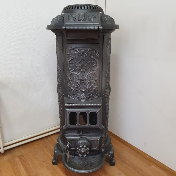 Cast- iron stove No. 1888 German cast furnace with fantastically playful decorations from around 1900