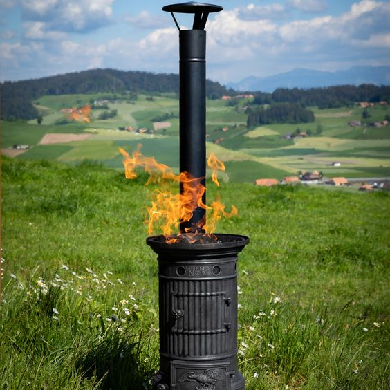 Small multifunctional cast-iron Clus stove with an insert for charcoal or wood