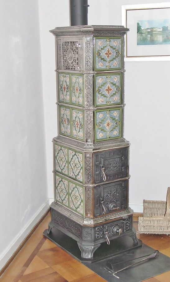 Two-tier freestanding tiled stove with original nickel-plated frame
