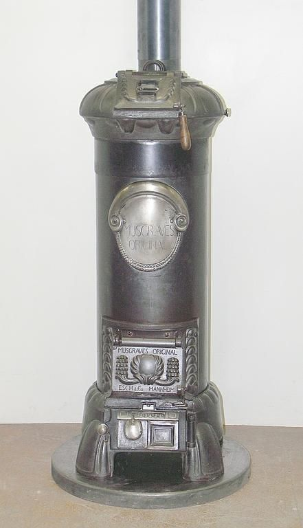 Cast-iron stove no. 1341 - Perler Ofen/ Musgraves original from Ireland, produced under licence by Esch & Cie. Mannheim. Cylindrical stove with stunning decorative features. Easy to fill from the top.
