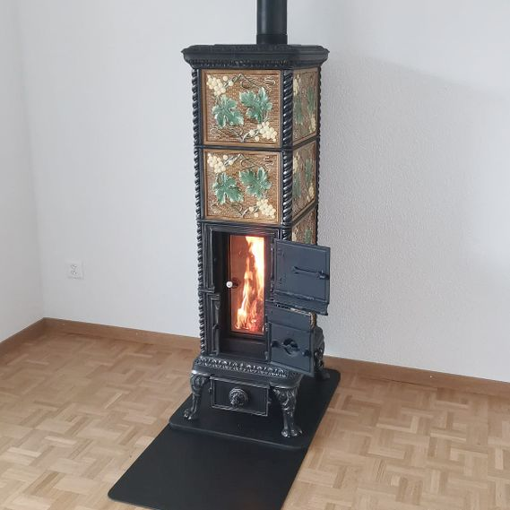 Lucelle freestanding tiled stove with large fire viewing panel