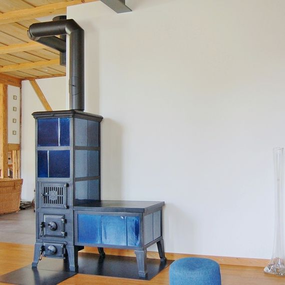 Klus tiled stove with bench circa 1920