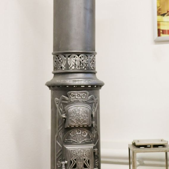 Cast-iron stove no. 1562, stunning Danish stove in classic Art Nouveau style. Fire door with mica glass for a view of the embers. The stove has stunning floral decorations.