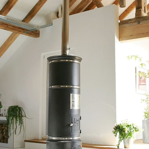Simple CH cylindrical oven at the heart of a large loft extension