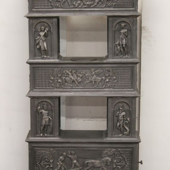 Cast-iron stove no. 752, lavishly decorated with motifs from Greek mythology featuring hunt and harvest scenes.