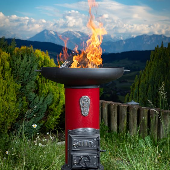 Cylindrical stove refurbished with a brazier for a wonderful atmosphere on warm summer nights.