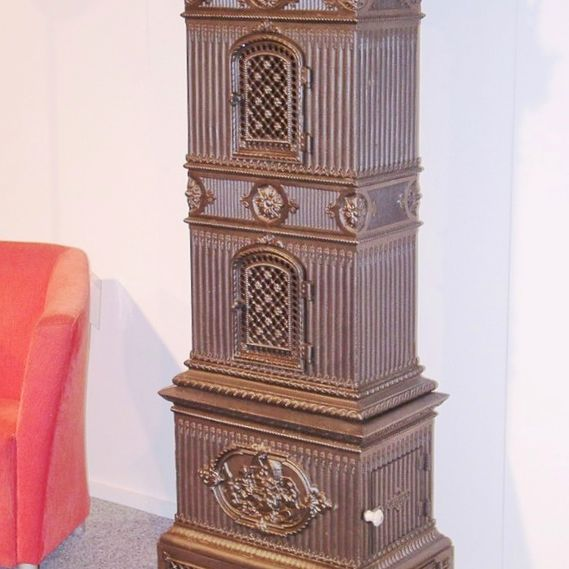 Cast-iron stove no. 128, lavishly decorated box stove capped off with a magnificent protruding crown.