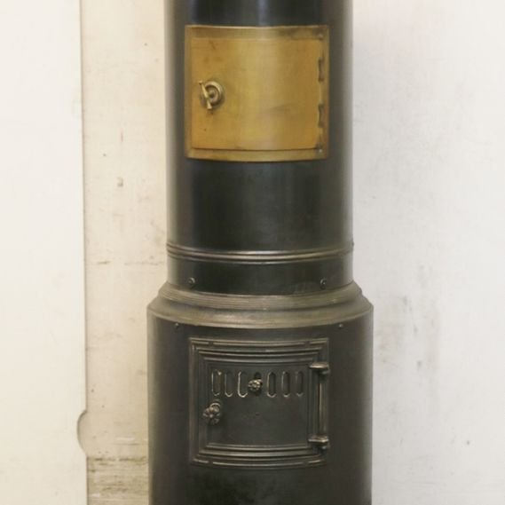 Cylindrical stove no. 1685, steel cover in stunning original patina. Designed by Affolter, Christen & Co.